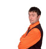 Man in orange shirt. Smiling young man in orange shirt and black waistcoat on white background Stock Images