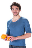 Man and orange Royalty Free Stock Photo