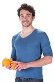 Man and orange Royalty Free Stock Photo