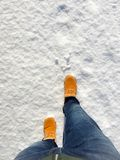 Man with orange winter boots walking Stock Photo
