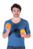 Man and orange Royalty Free Stock Photography