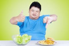Man with organic salad and burger Stock Photo