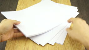 Man organize empty paper on wood background Royalty Free Stock Photo