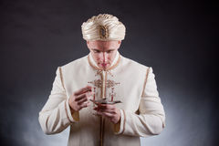 Man in oriental costume Royalty Free Stock Photo