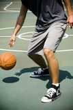 Man on an outdoor basketball court, close up Royalty Free Stock Image