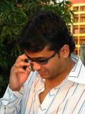 Man outdoor on cellphone Royalty Free Stock Photos