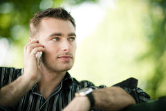 Man outdoor on cellphone Royalty Free Stock Photos