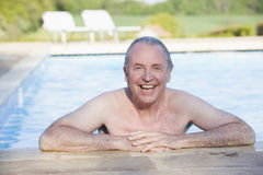 Man in outdoor pool smiling Royalty Free Stock Image