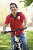 Man outdoors on bike smiling Stock Images