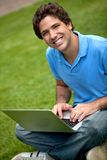 Man outdoors with laptop Royalty Free Stock Photography