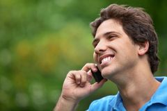 Man outdoors on the phone Stock Images