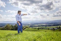 Man outdoors pointing Stock Photos