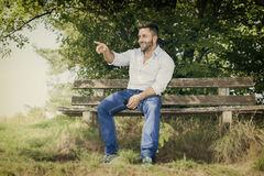 Man outdoors pointing Stock Photo