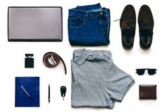 Man Outfit. Outfit of clothes young man with vintage blue jeans, grew shirt, brown suede shoes, clubmaster sunglasses, purse and other on the white background stock photography