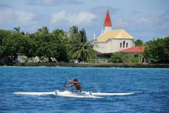 Man in Outrigger Canoe Stock Photography