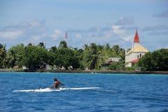 Man in Outrigger Canoe Stock Photos