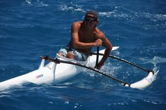 Man in Outrigger Canoe Royalty Free Stock Photography