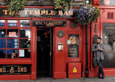 Man outside a bar in the Temple Bar neighborhood in Dublin, Ireland Royalty Free Stock Images