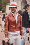 Man outside Cavalli fashion shows building for Milan Women's Fashion Week 2014 Royalty Free Stock Photography