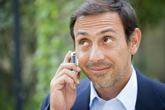 Man outside on cell phone Royalty Free Stock Image