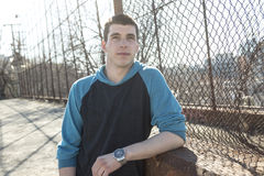 Man outside close to a fence without feeling Stock Photos