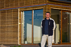 Man outside new eco home Stock Photography