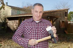 Man outside showing sharp axe. Man outside showing a sharp axe Stock Images