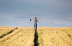 Man with outstretched arms in field Royalty Free Stock Images