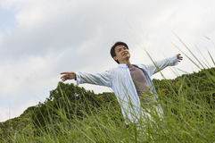 Man outstretching arms in nature Stock Images