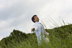 Man outstretching arms in nature Royalty Free Stock Images