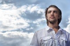 Man over blue sky Stock Photo