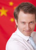 Man over china flag. Portrait of businessman in front of china flag stock photography