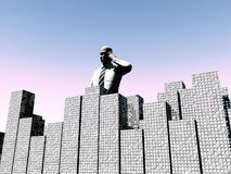 Man Over City 2. An conceptual image of a man standing over a city that he works in Stock Photos