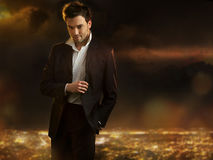 Man over night city background. Elegant young handsome man over night city background Royalty Free Stock Photography