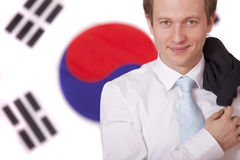 Man over south korea flag. Happy politician in front of south korea flag stock images