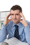 Man is over-worked. Man in the office is over-worked Stock Image