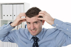 Man is over-worked. Man in the office is over-worked Royalty Free Stock Images