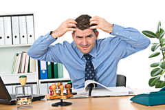 Man is over-worked. Man in the office is over-worked Royalty Free Stock Photos