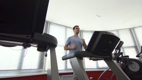 Man over 30 years old, on a running simulator stock video