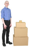Man in overalls and cardboard boxes Royalty Free Stock Images