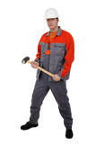 Man in overalls with a hammer in his hands Royalty Free Stock Photo
