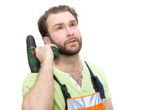 Man in overalls with a hammer Stock Photo