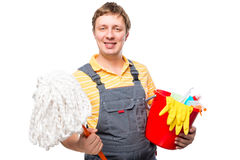 Man in overalls holding a mop and cleaning products. On a white background Stock Images