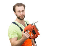 Man in overalls with a jigsaw Royalty Free Stock Photo