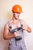 Man in overalls with a screwdriver Royalty Free Stock Image