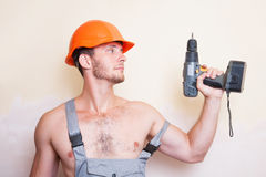 Man in overalls with a screwdriver Royalty Free Stock Photo