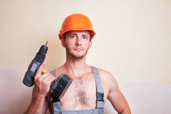 Man in overalls with a screwdriver Stock Image