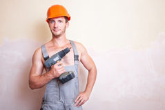 Man in overalls with a screwdriver Royalty Free Stock Photography