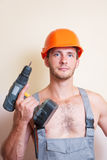 Man in overalls with a screwdriver Stock Images
