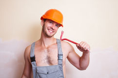 Man in overalls with a tool for dismantling Royalty Free Stock Images